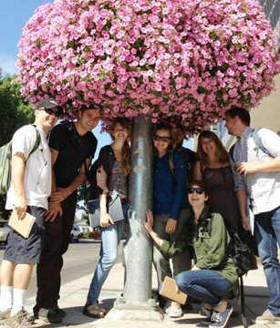 A group of students underneath flowers