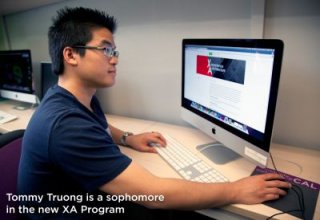 Tommy Truong works on computer